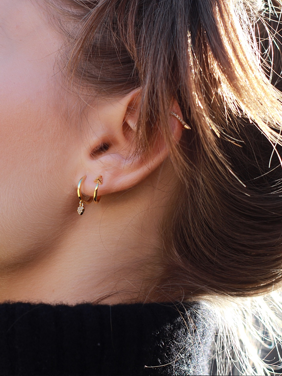 HOOPYR gold earrings